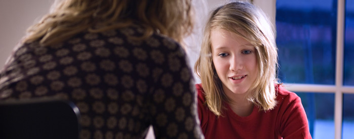 Young teen speaking with a counsellor