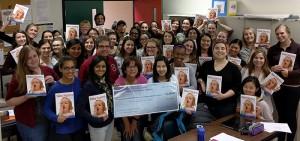 Durham Men of Harmony make donation to Communicative Disorders Assistant program
