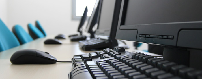 Desktop computers with keyboards and mice