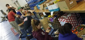 Volunteers filling food hampers at DC's annual holiday food drive