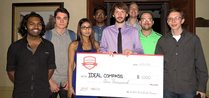 Group of students holding a giant cheque