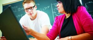 A professor assisting a student, ensuring his success