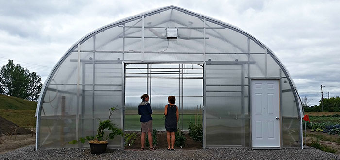 Master gardeners tour hoop house at Centre For Food.