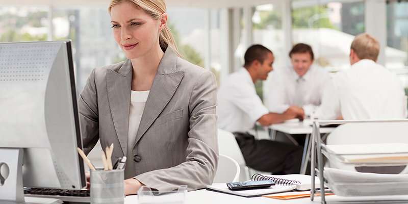 Woman in suit using computer