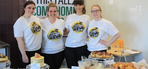 Students pose for photograph at the Bake Shop sale at Whitby campus.