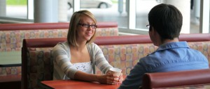 two students chatting over coffee