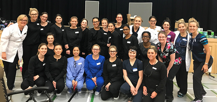 DC dental hygiene students taking care to clients of Health Mission Outreach in Brampton - Group Shot