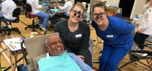 Two DC dental hygiene students and a patient