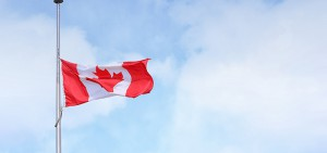 Canadian flag at half mast.