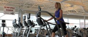 a woman walking on a treadmill