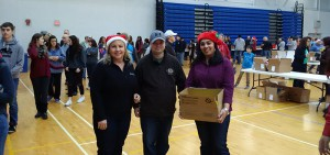 Alumni Association board president and members lend a helping hand packing hampers.