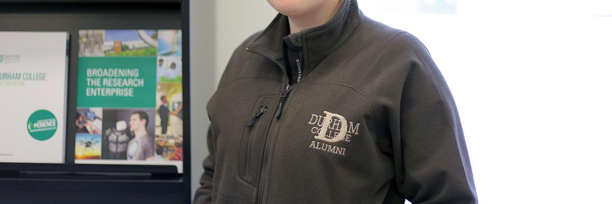 a female Durham College alumnus in a Durham College jacket