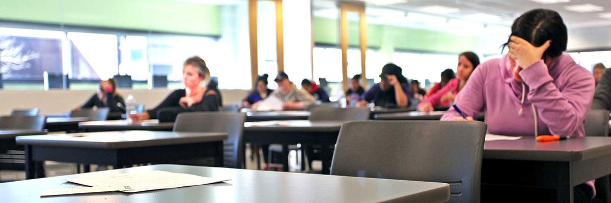 Empty desks in exam room