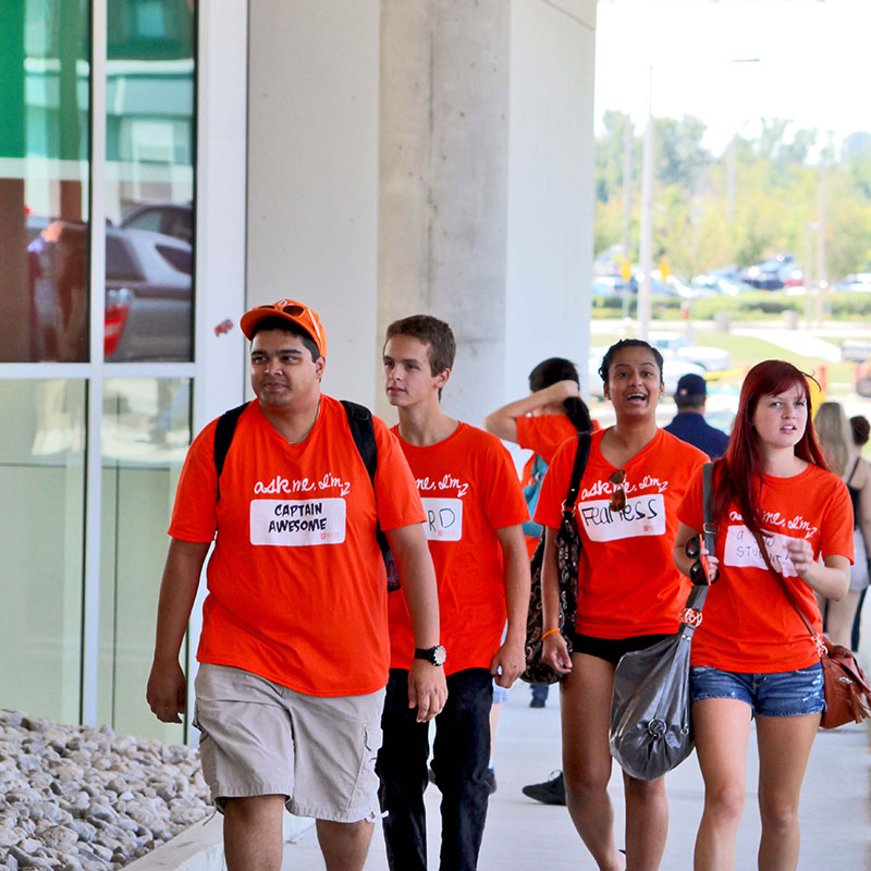 Students walking by the Student Services Building
